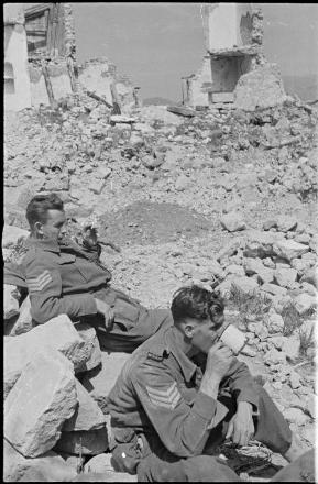 SJT E.D Bougen (Right) taking a break amongst the rubble of Monte Cassino, Italy 1944.