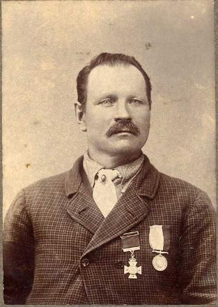 Thomas Adamson wearing his NZ Cross and NZ Medal