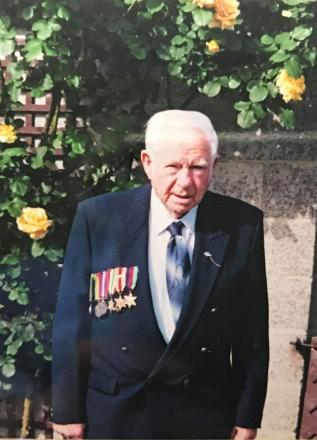 Photo of Gordon Brand with his service medals.