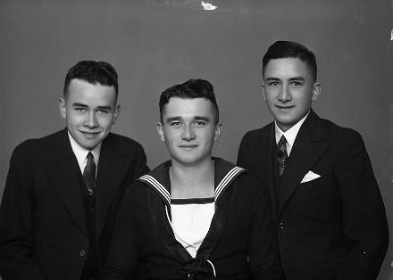 Group of three Maori men, one wearing a navy serviceman uniform. They are the sons of William Norton Bertrand and Queenie Emma Bertrand, of Purangi. From left: David Bertrand, Fergus Bertrand and Bennett Llewllyn Bertrand (also known as Benne). Bennett was killed in action, 7 June 1944, aged 20.