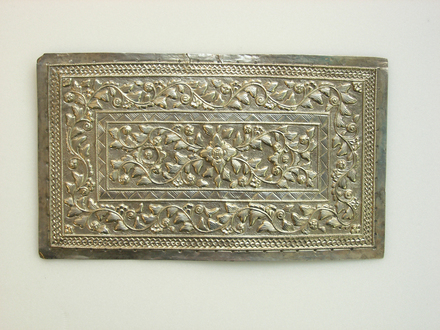 ornate metal plaque