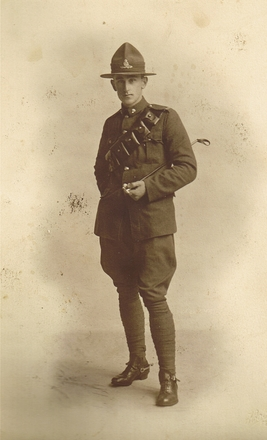 Jack Cameron Bailey full length portrait, leather bandolier, hat - No known copyright restrictions