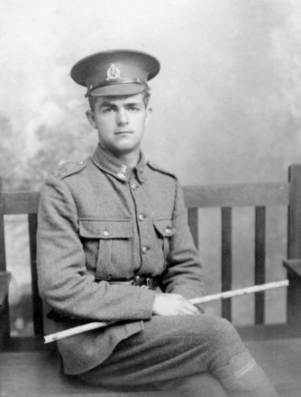 Portrait, William Bridge 1916, aged 19, seated holding staff, cap with Reinforcements badge, Rifle Brigade collar badges, shoulder badge (brass) on left epaulette ? 20th Reinforcement? (photograph provided by Sandra Baker 2008). - No known copyright restrictions