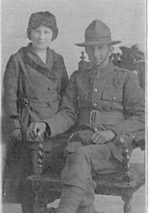 Couple, soldier in uniform D.L Bruce, seated and ?Jean McKee taken 1917 - No known copyright restrictions