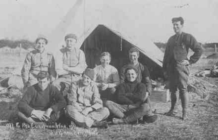"Quarantine Camp or ""The happy family"" (New Zealand) on 30 August 1915 before leaving for the war. In the photo (back row) T. Brent, D. Hartnett, C.H. Senior, A.G. Nell; (front row) Conway, T. Caskey, A.W. Heald. Standing to the right Eastwood. This may be T. Caskey but would need to be verified. - No known copyright restrictions"