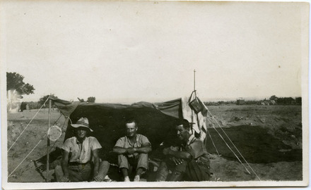 Group 3 men seated outside tent: Syd Aymes (sic) (13301) centre; James Cornfoot (13317) and unidentified man front - No known copyright restrictions