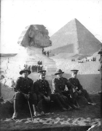 Group sitting in front of the sphinx, Egypt - 4 men from 3 Company Auckland Infantry Regiment, c February 1915. L-R Pte Hayter (12/129), Jock McKenzie (12/160), Lt Frater (12/1026), Pte AB Fordyce (12/102). Photo by Private R.B. Steele (12/604). Image provided by family - No known copyright restrictions