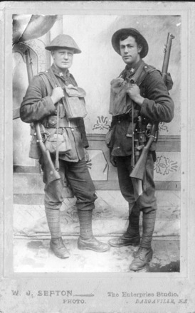 Group photo, 2 soldiers: James Alison Hume (6/3355), Richard Askew Hume (6/3356), (right) before embarkation to WWI, dressed full kit, rifle, knife, tin hat, and other equipment - No known copyright restrictions