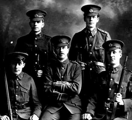 Group photo taken by Schmidt Studio. No. 1 Native B Company, 3rd Auckland Infantry Winners: Champion Teams Match and Victoria Banner, Waikato Match, Cambridge Match and 2nd Te Aroha Match. South Auckland Rifle Association 29 January 1912. Back Row: Corporal A.G. Devore, Private E. Lippiatt. Front Row: Sergeant A. Purchase, Captain M.N. Atkinson, Sergeant C. Smith. - No known copyright restrictions