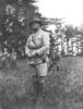 Herbert Albert Edwin Milnes standing in a field - No known copyright restrictions