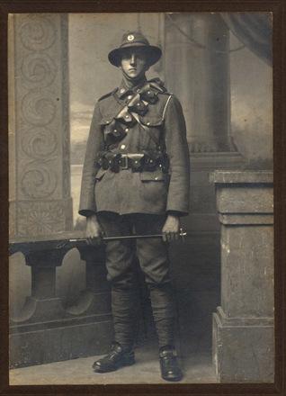 CR Perrett, P Fever in uniform khaki, bandolier, belt - No known copyright restrictions