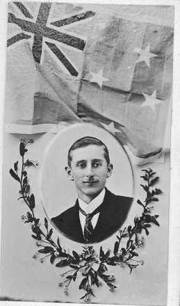 Portrait, oval in civilian clothes, depicts New Zealand flag and wreath of flowers from a memorial card - No known copyright restrictions.