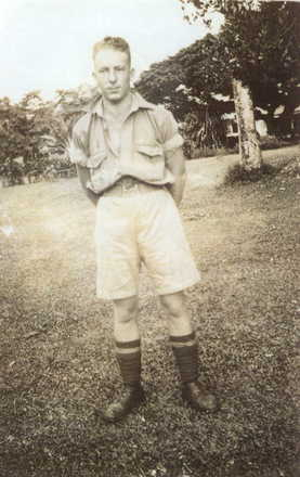 Portrait, L Bartlett, informal standing wearing shorts, sleeves rolled up. - This image may be subject to copyright