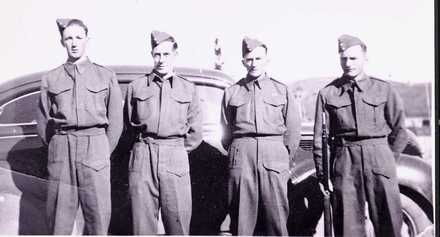 Group 4 Home Guard soldiers at Mataroa, near Taihape standing in front of car, George Whale, Vern Neagle, Alex Arrow and Percy Arrow (Taihape Museum) - This image may be subject to copyright