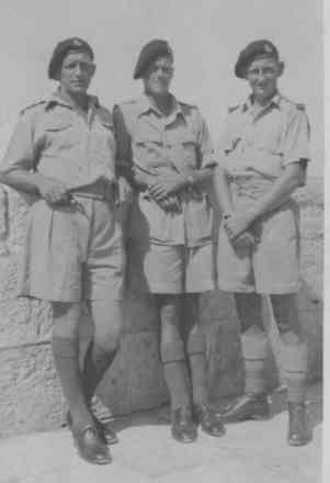 Group, WW2, 3 soldiers, leaning against stone wall, Peter Greenfield centre (kindly provided by family) - This image may be subject to copyright