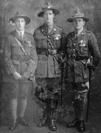 J.G. Grant is on the right beside fellow VC recipients Harry Laurent and Leslie Andrew (middle). - No known copyright restrictions