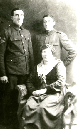 Family group WW1, soldier Jack Hudson on right with his brother, also in uniform, and sister. Photo taken while in UK on Convalescence leave. - No known copyright restrictions