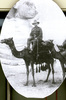 Portrait, sitting astride a camel, sphinx in background - No known copyright restrictions