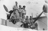 Group: Crew 13, No. 6 (Flying Boat) Squadron, RNZAF, taken at Lauthala Bay, Fiji, dated 7 April 1944. Front Row: Flight Sergeants Ray Lowther (Captain); Al Furness (1st WAG); Graham Rough (1st Engineer); Fred Walker (2nd Engineer); 'Cookie' Cook (3rd Engineer). Back Row: Bill Lamason (2nd Pilot); Joe Garrity (2nd WAG); Claude Baigent (Navigator). - This image may be subject to copyright
