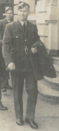 Portrait, WW2, RNZAF, Cyril Robert Hudson McFarlane walking in street, coat on arm, C 1941 (Photo Hodder family) - This image may be subject to copyright