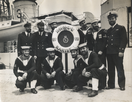 HMNZS Kaniere, Group 10 sailors, informally photographed on the wharf beside HMNZS Kaniere , William S. Watson is the tallest. 1956 (photo supplied by family) - This image may be subject to copyright