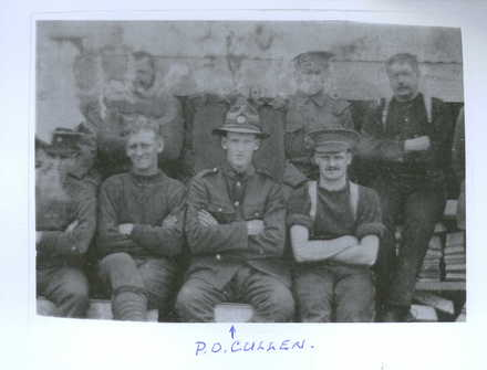 Group photograph, Phillip Cullen centre, with full uniform, companions in in various uniforms including sleeves rolled up, braces, different hats - No known copyright restrictions