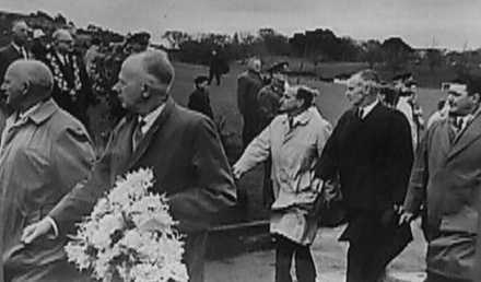 Photograph of wreath laying ceremony courtesy 21 Battalion Association. Captain W.E. von Schramm MiD, ED, carrying wreath. (Note Sir Dove Meyer Robinson standing on grass - wearing mayor chain) - This image may be subject to copyright