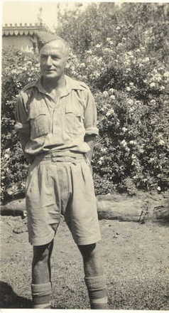 Portrait, William R. Harrison in uniform standing in a garden - This image may be subject to copyright