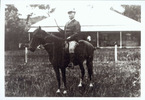 Portrait, Maillard Noake on his horse Jubilee, in the background the Onoke House built for Judge Manning, Onoke, Hokianga - No known copyright restrictions