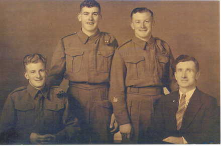 Family group, 3 soldiers in uniform and one in civilian clothes: L-R Chapman Gould, A.R. Gould, Silas James Gould and Silas James Llewelyn Gould. - This image may be subject to copyright