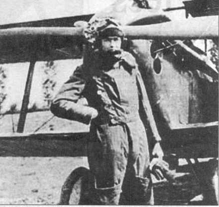 Ronald Burns Bannerman WW1 in flying kit standing in front of propellor - No known copyright restrictions