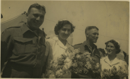 Wedding Group, WW2, Caserta, Italy 7 May 1944, groom Hubert Crispin and bride Mary Crispin nee Stapleton in nurses uniform. Attendants, unidentified man in uniform and nurse with bouquet. - This image may be subject to copyright