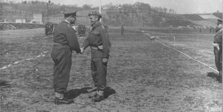General Freyberg congratulates John Horrocks is moments after pinning the MC. - This image may be subject to copyright