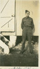 Portrait, Sid, 1940 in uniform, standing outside corrugated iron clad building at Trentham - This image may be subject to copyright