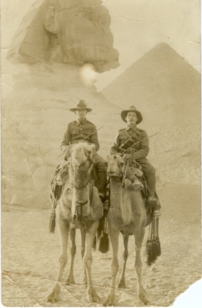 Group, 2 soldiers on camels, Herbert Everett (on left) on camel in Egypt. Verso contains partial message [due to damage] to Everett's mother dated 22 March 191[?5]. (photo kindly provided by Helen Bockweg (née Everett), Herbert Everett's daughter) Auckland War Memorial Museum - Tāmaki Paenga Hira PH-2005-37 - No known copyright restrictions