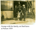 """Group, """"George on his final leave at Nelson, 1939""""; soldier, wife?, mother? and boy and girl standing before a wooden house, ladder and broom leaning against wall, plants in garden - This image may be subject to copyright"""