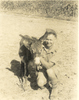 Portrait, WW2, Morris crouching down holding a small donkey, Egypt 1941. (photo kindly provided by family) - This image may be subject to copyright