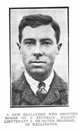 """Portrait, """"A New Zealander who dropped bombs on a Zeppelin. A cable message from London under the date of April 3, states that Flight-Lieutenant Brandon on Friday night rose to a height of 6000ft and then saw a Zeppelin 3000ft higher. Rising above the airship, he dropped several bombs, and it is believed three took affect."""" published in the Auckland Weekly News, April 13 1916, p. 50 - No known copyright restrictions"""