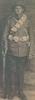 Portrait, WW1, standing, bandolier, rifle, Thomas Marsden Harwood, c1915 may be taken at Putorino, Hawera - No known copyright restrictions