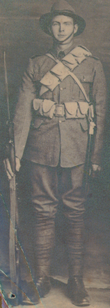Portrait, WW1, full length with rifle, bandoliers, helmet - No known copyright restrictions