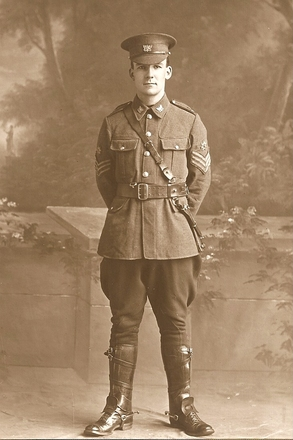 Portrait, WW1, Leslie Buchanan photographed at Schmidt Studios in his Quartermaster Sergeant's uniform in the 3rd. Auckland Mounted Rifles July 8, 1915 - No known copyright restrictions