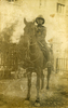 Portrait, astride a horse, pith helmet, postcard stamped, front (kindly provided by family) - No known copyright restrictions