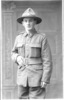 Portrait, Wakefield's Ealing, London, postcard stamped Post Card divided 212550, not franked front: 1918 Private Griffin in a studio pose, standing, hand in belt, lemon squeezer hat - No known copyright restrictions