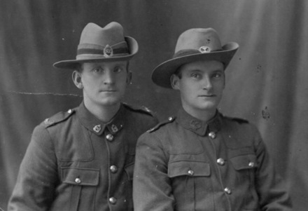 Group, 2 soldiers, seated wearing hats, 8/2624 Robert Hyndman (left) and unnamed soldier - No known copyright restrictions