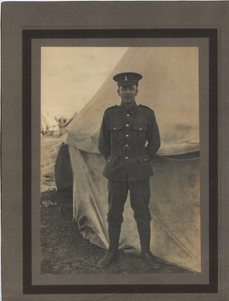 Portrait, Alexander Robertson McPhail (24/863) standing at ease in front of a tent (kindly provided by family) - No known copyright restrictions