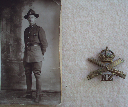Portrait, Fred standing, studio portrait and Machine Gunners badge (kindly provided by family) - No known copyright restrictions