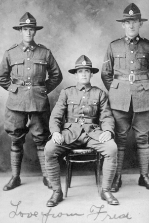 "Group, WW1, three soldiers, studio portrait, standing left Frederick George Owen Baker other soldiers unknown, message written on the bottom ""Love from Fred"". - No known copyright restrictions"