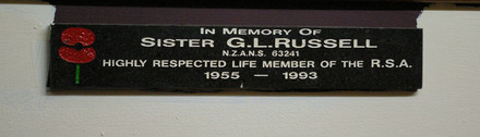 Detail, plaque commemorating Sister Gladys Joan Robertson (63241) beneath the NZ Returned Army Nursing Sisters Assoc. (Ackl) honours board (photo J. Halpin April 2012) - This image may be subject to copyright