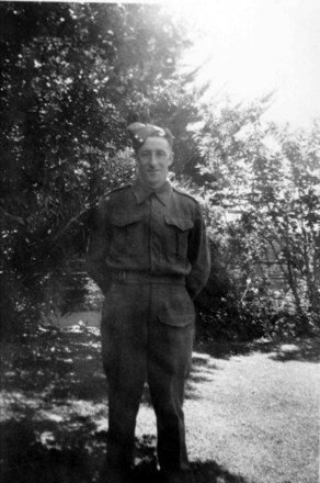 Portrait Richard Collister standing in a garden - This image may be subject to copyright