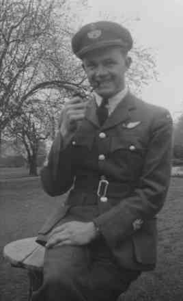 Portrait, Michael de la Cour Davies in uniform smoking a pipe - This image may be subject to copyright